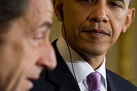 Sarkozy, left, expressed support for Obama's push for UN sanctions against Iran [AFP]