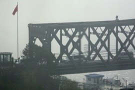 Vehicles crossing the Friendship Bridge linking North Korea's Sinuiju with Dandong on Monday [Reuters]