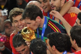 Spain captain Iker Casillas kisses the trophy as his team wins the World Cup for the first time [AFP]