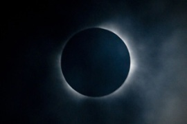 The eclipse swept across the South Pacific, plunging remote islands into darkness [AFP]