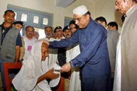 President Asif Ali Zardari has visited flood victims in affected areas, but some say he is too late [AFP]