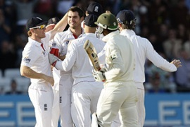 Anderson, second left, took the wicket of Amin, front, for one run on the third day of the first match [AFP]