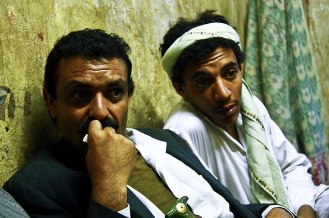 "Her father, Mabkhout as Sabahi, left, earned 200,000 Yemeni Rial, around $1,000, for agreeing to the marriage to Nabil. ""Nabil promised he would wait for her until she was grown up,"" said Mabkhout. ""But the people in Hajja [where Nabil is from] kept telling him Sally is grown up and ready to sleep with him and that she does not because her parents told her not to."" [Credit: Annasofie Flamand]"