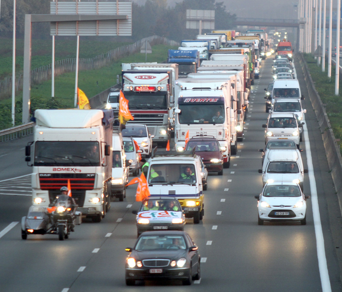 Lorry drivers have demonstrated by slowing down traffic on motorways [AFP]