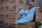 A Pakistani man rests before loading a cargo ship in Dubai [File: Dan Kitwood/Getty Images]