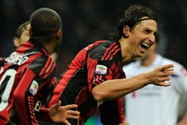 Milan go four points clear