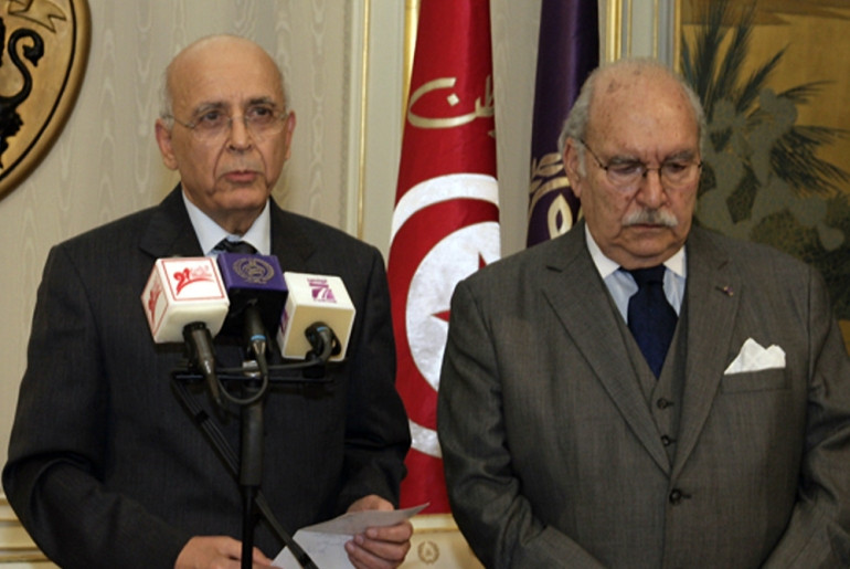 The prime minister, Mohammed Ghannouchi, left, briefly became the interim president. He cited chapter 56 of the constitution as the article by which he was assuming power [AFP]