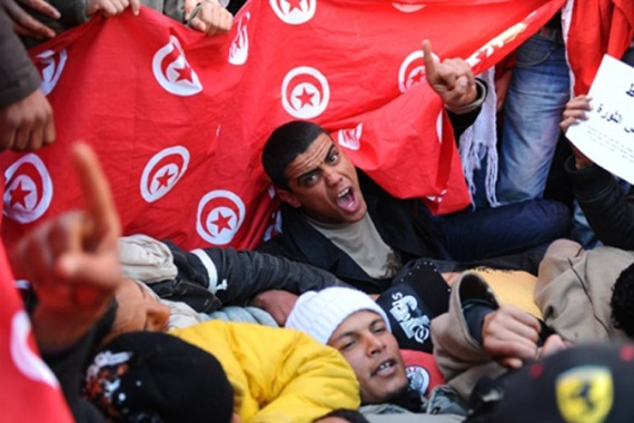 In this file photo from 2011, inhabitants of Sidi Bouzid chant slogans during a demonstration in front of the government palace in Tunis [File: Fethi Belaid/AFP]