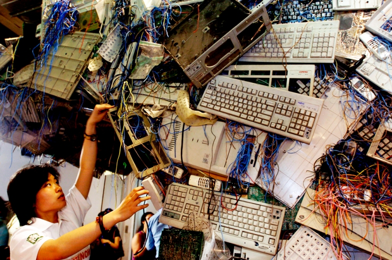 Chinese Greenpeace activists set up an e-waste sculpture at the China International High-tech exhibition in an effort to shame the companies attending the expo on May 23, 2005 in Beijing, China [Getty]