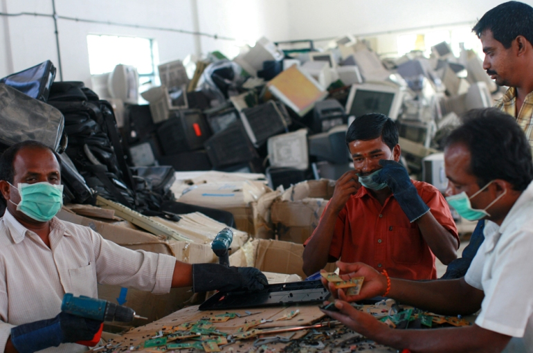 Workers dismantle old computers and electronics at E-Parisara, an electronic waste recycling factory. India(***)s growing digital economy has contributed to the amount of e-waste it generates [Getty]