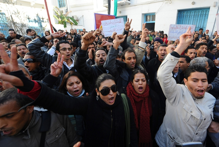 The uprising began on December 17 in the town of Sidi Bouzid, where a 26-year-old university graduate set himself on fire in desperation over the country(***)s high unemployment rate. Anti-government protests erupted soon afterwards [AFP]