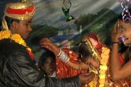 A 12-year-old girl is married to a 20-year-old man in Siraha District, Nepal [Al Jazeera]