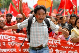 Nepalese activists rallied in Kathmandu on International Labour Day, a symbol of global workers(***) solidarity, on Sunday [EPA]