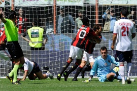Milan need a point to secure title