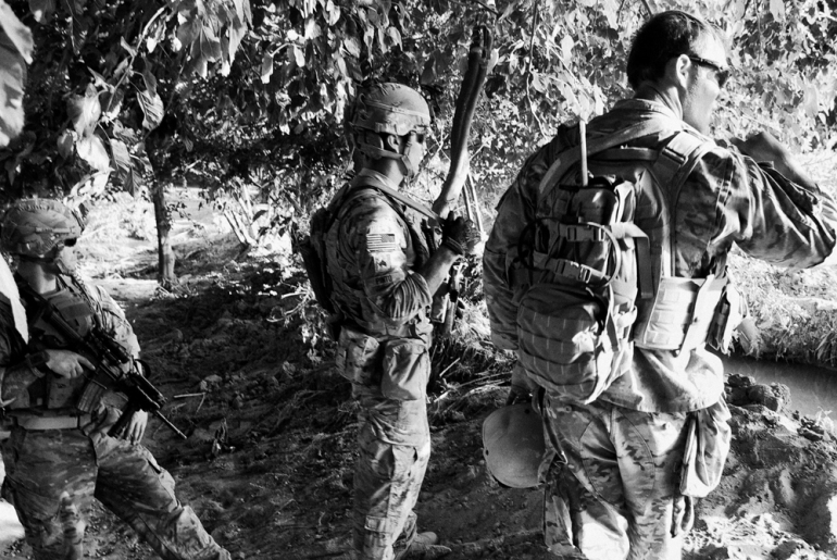 1 Platoon, Delta Co, 1-66, 4th Infantry Division, patrol an orchard in Arghandab Valley in Kandahar, on the day the so called (***)Taliban Tet Offensive(***) was due to start [John D McHugh]