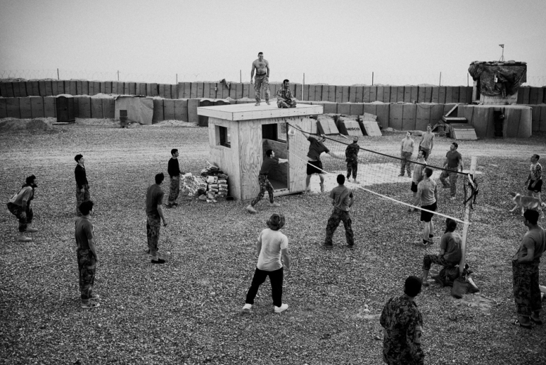 Soldiers from 1 Platoon, Delta Co, 1-66, 4th Infantry Division, play a game of volletball against their Afghan National Army partners in the Arghandab Valley, Kandahar [John D McHugh]
