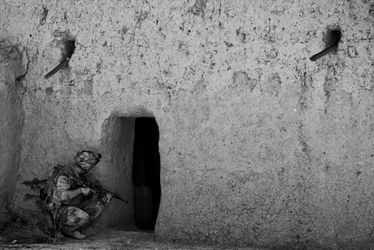 PFC Fulford from 1 Platoon, Delta Co, 1-66, 4th Infantry Division, searches for arms caches and IEDs around Jazah village in the Arghandab Valley, Kandahar [John D McHugh]