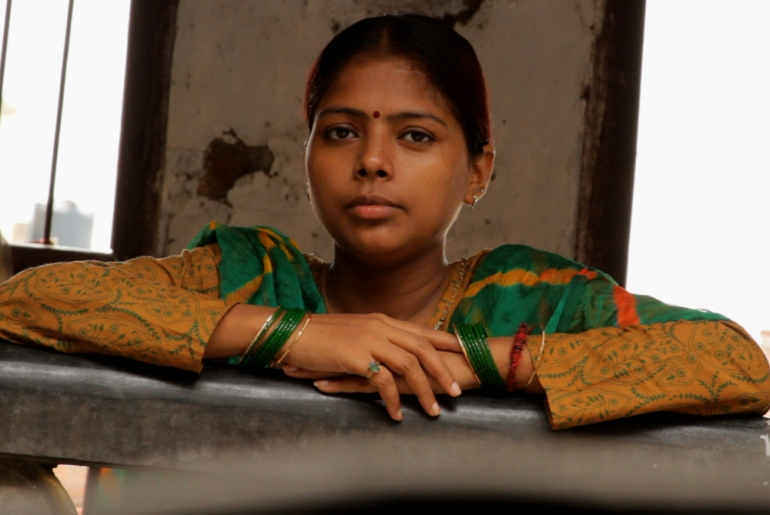 Naseema was the first girl from the brothel to get an education. She set up her own NGO called Parcham, which means flag