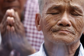 Bou Meng, a rare survivor of the Tuol Sleng prison, wants trials finished before Khmer Rouge leaders all die [Reuters]