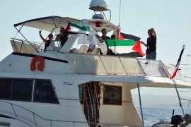 Israel under fire over flotilla warning