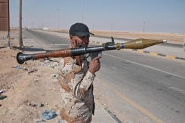 A rebel mans an RPG at a checkpoint just west of Ajdabiya [Credit: Jeremy Young]