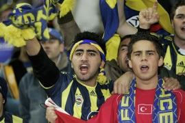 Angry Fenerbahce fans storm pitch