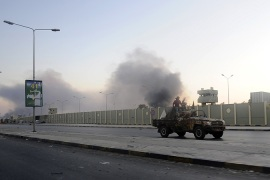 Rebels fight for control of Tripoli district