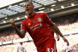 Liverpool dominate Bolton to move top