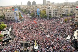 Thousands rally in support of Syria's Assad