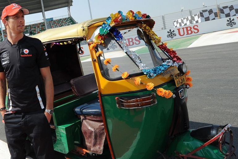 McLaren driver Jenson Button took a tuk-tuk for a spin around the circuit ahead of the GP but will be hoping for something a bit faster to drive on the big day [AFP]