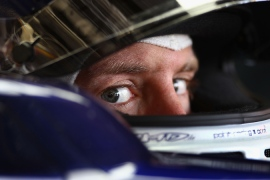 Vettel snuffs out Button challenge