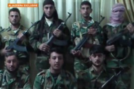 Defectors battle Syrian security forces
