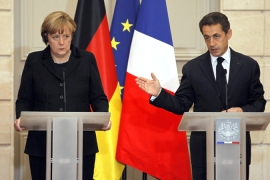 Sarkozy and Merkel call for new EU treaty