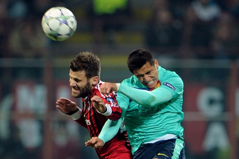 Clash of the Titans: The mighty Barcelona and AC Milan were pitted against each other in Group H. Both sides made it through to the last 16 of the Champions League. Here Antonio Nocerino of Milan (L) and Alexis Sanchez of Barca compete for the ball in a hotly contested match that ended 3-2 to Barcelona. The Catalan giants went through as group winners with Milan runners up. Will they meet again... quite possibly [GALLO/GETTY]