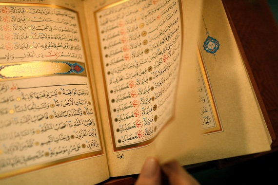 A crowd seized two men after they were accused of stepping on a Quran in a mosque [File: Ralph Orlowski/Getty Images]