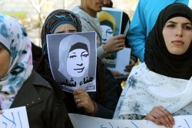 Protesters hold pictures of Palestinian prisoner Hana al-Shalabi, on hunger strike for three weeks [EPA]