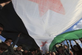 Syria's Alawite activists stuck in the middle