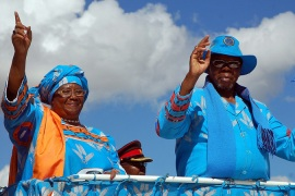 Banda, left, was expelled from the ruling party by Bingu wa Mutharika, right, after a succession battle [AFP]