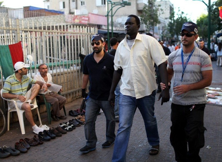 A migrant from southern Sudan is arrested by israel immigration and population department officers in Tel Aviv.