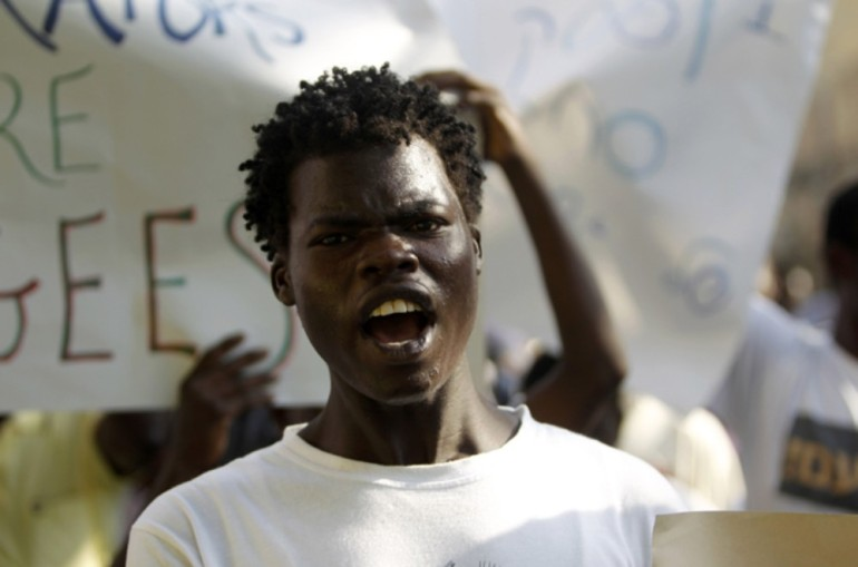 A Sudanese man shout slogans during a demonstration in Tel Aviv against the deportation of migrants from South Sudan.