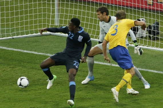 England's Danny Welbeck (L) scores their third goal against Sweden in the group stages of Euro 2012 [Reuters]
