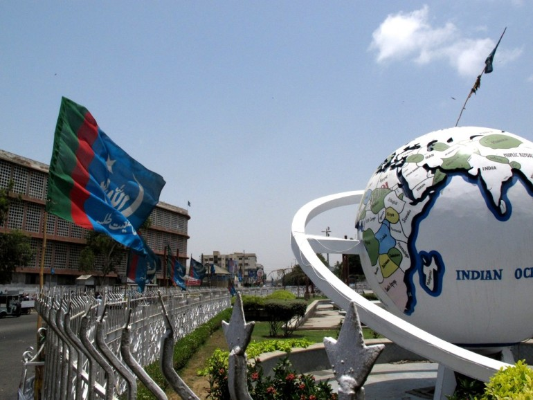 Flags play an important role in asserting a party(***)s control over a neighbourhood. This Jamaat-e-Islami flag flies near the city(***)s Globe Intersection, in Jamshed Quarters.