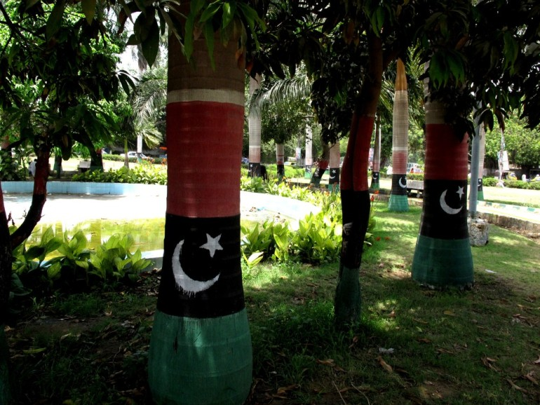 Trees, too, aren(***)t quite safe from the political parties: these, located in a park near the Mausoleum of Pakistan(***)s founder, are painted in the three colours of the PPP.