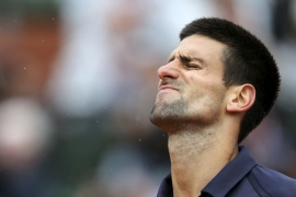 Top seed Novak Djokovic(***)s bid to become just the third man to hold all four Grand Slam titles at the same time was shattered by Rafael Nadal at the French Open. The Serbian needs to make the final at the All England Club to keep his number one ranking [REUTERS]