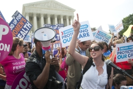 The Supreme Court concourse in Washington erupted in celebration - and protest - as the decision was revealed [AFP]