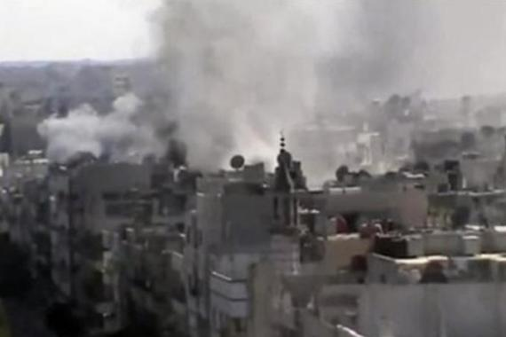Amateur video released by the Syrian opposition purports to show explosions in the Khaldiyeh area of Homs [AP]