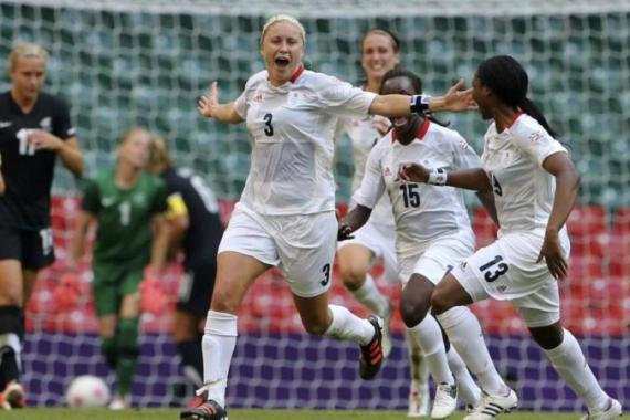 Houghton (L) celebrates scoring a goal that secured a historic win and match for the Great British team [Reuters]