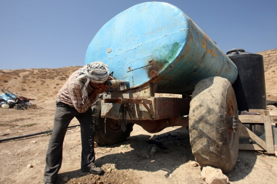 Palestinians in the Jordan Valley have very little access to water, living on 10-20 litres a day [EPA]