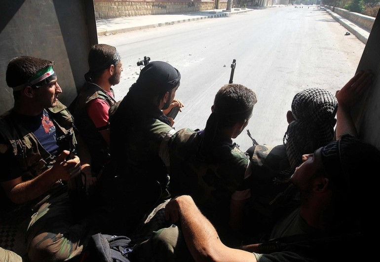 Syrian rebels patrol near Aleppo. Fierce fighting has erupted in the city over the last couple days, with the London-based Syrian Observatory for Human Rights now estimating the total death toll to be over 20,000 since the uprising began.