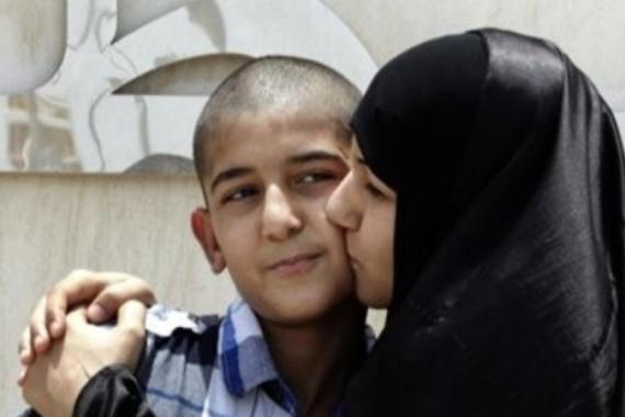 Khadija Habib kisses her son, Ali Hasan, after he was released from prison in June. [AP]